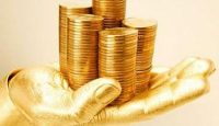 golden hand holding golden coins